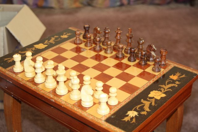 Indian Wood Chess Set on Musical Chess Table.JPG | Exeter Chess Club